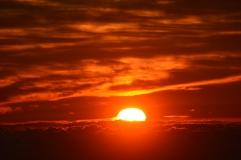 Sun cresting clouds